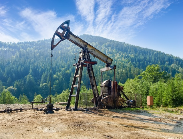Oil well with pump-jack in the Carpathian Mountains